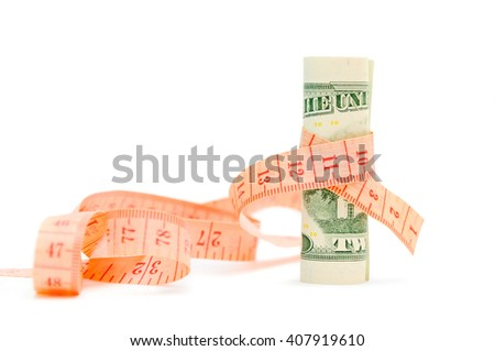 Compression of the budget of financing. Financial concept. Measurement of a banknote of twenty dollars ruler. - stock photo