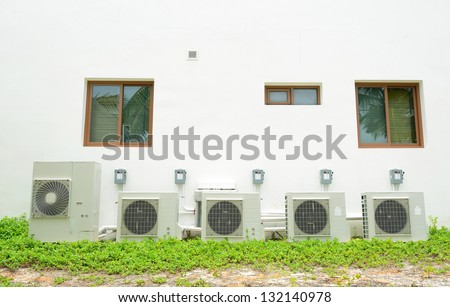 Compressor of air condition are set behind the building - stock photo