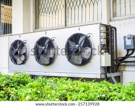 compressor unit of air conditioner installed outdoor  - stock photo