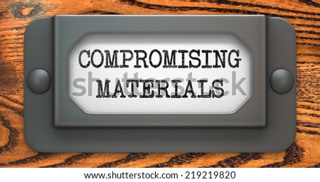 Compromising Materials - Inscription on File Drawer Label on a Wooden Background. - stock photo