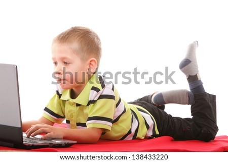 Computer addiction child boy with laptop notebook isolated on white background