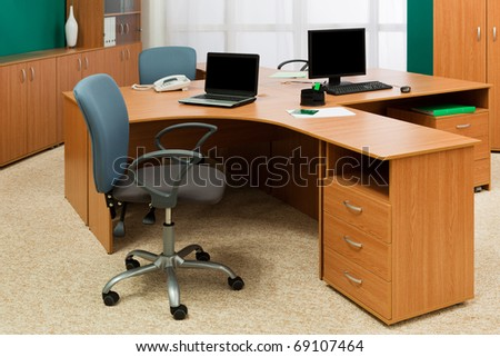 computer and laptop on a desk at modern office - stock photo
