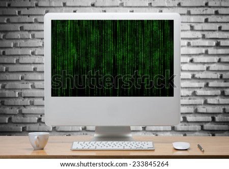 Computer and wireless keyboard,mouse on wooden table with matrix code in screen.clipping path  - stock photo