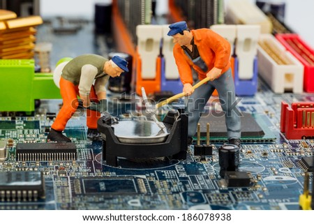 computer board and workers, symbol photo for computer failure, maintenance, data security - stock photo