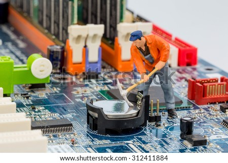 computer board and workers, symbolfoto for computer failure, maintenance, data security - stock photo