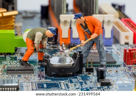 computer board and workers, symbolic photo for computer failure, maintenance, data security - stock photo