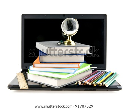 computer, books,pencils and a globe on a white background - stock photo