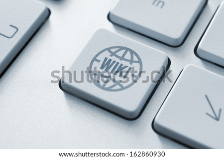 Computer button on a keyboard with online wiki encyclopedia icon symbol - stock photo