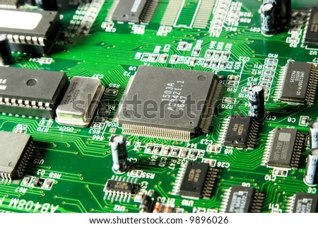 Computer chip closeup. Green tint. - stock photo