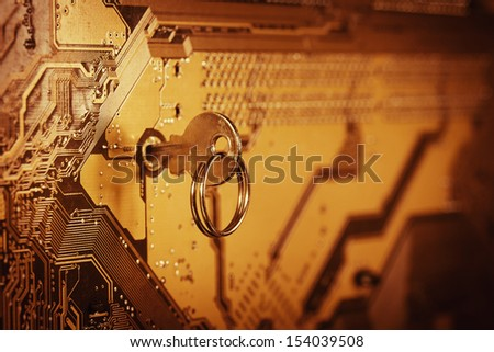 Computer chip with key - stock photo