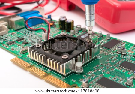 Computer circuit board, screwdriver and instruments in the laboratory - stock photo