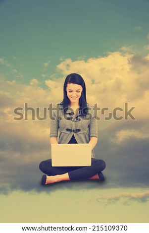 Computer cloud concept with young woman in the sky - instagram filter - stock photo