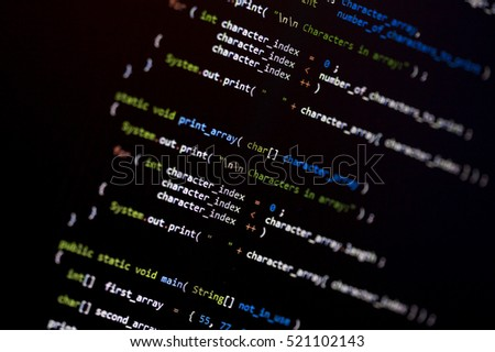 Computer code language on a screen with shallow depth of field. Image taken in an angle.