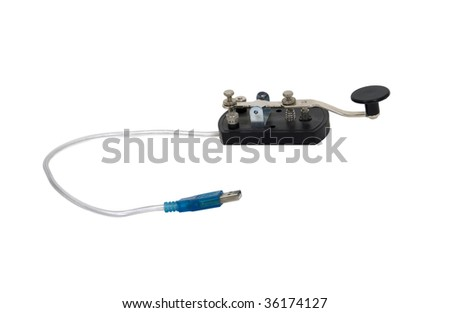 Computer communications shown by an antique telegraph key used as a Morse code communication device with a USB connection - path included - stock photo