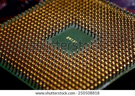 computer cpu (central processor unit) chip on main board from close-up - stock photo