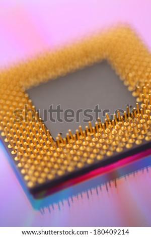 Computer cpu processor chip on purple background - stock photo