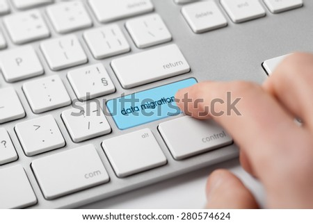 Computer data backup concept - data migration on keyboard. - stock photo