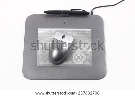 Computer drawing tablet with pen. Isolated on white - stock photo