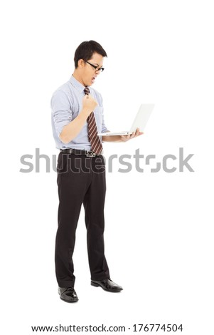 computer engineer is  standing and clench his hand - stock photo