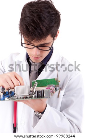 Computer engineer working on an old motherboard
