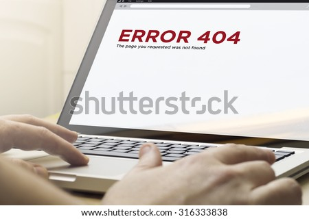 computer error concept: man using a laptop with error 404 on the screen. Screen graphics are made up. - stock photo