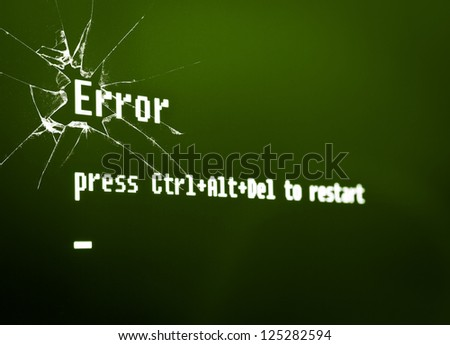 "Computer error message ""Error, press Ctrl + Alt + Del to restart"" on the broken screen. High detailed computer screen photo. - stock photo"