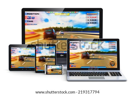 Computer gaming and entertainment technology concept: gamer desktop PC, laptop or notebook, tablet and metal touchscreen smartphone with auto racing sport video game isolated on white background - stock photo
