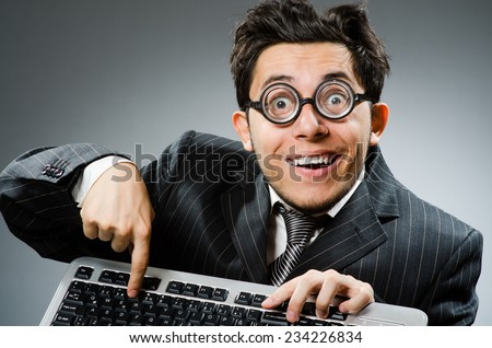 Computer geek with computer keyboard - stock photo