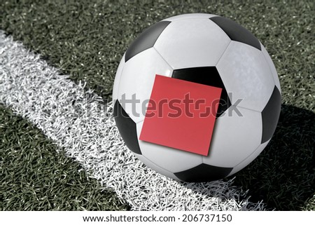 Computer Generated Soccer Ball with a Sticky Note on a Soccer Field - stock photo