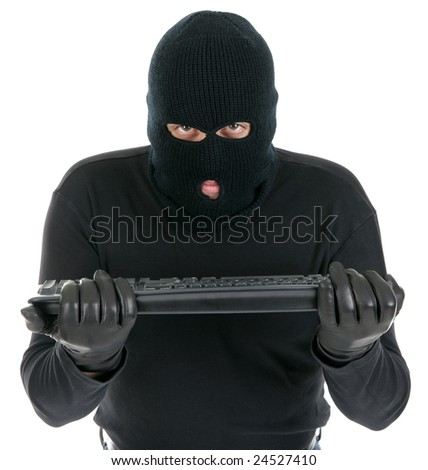 Computer hacker - criminal with the keyboard - stock photo