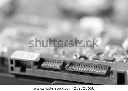 computer hard disk drive close-up shot. shallow depth of field. macro. connection plate - stock photo