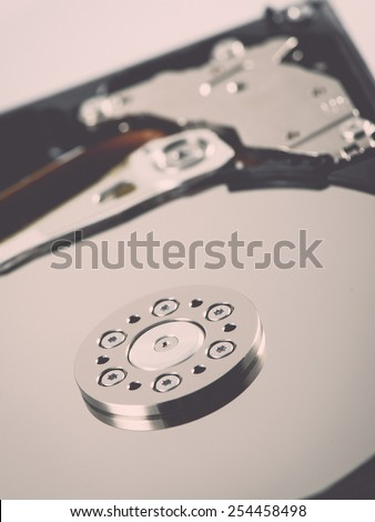 computer hard disk drive close-up shot. shallow depth of field. macro - retro vintage effect - stock photo