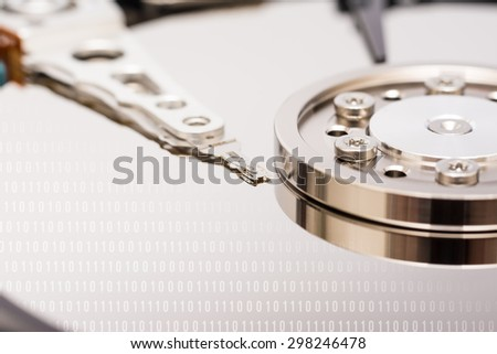 Computer Hard Disk Drive Internals And Binary Number Code - stock photo