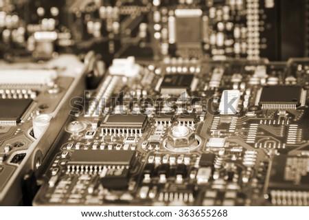 Computer Hard Disk Electronics Circuit, Macro Photo. Hard disk repairing concept, Data saving concept. Blur background with selective focus. Sepia effect. - stock photo
