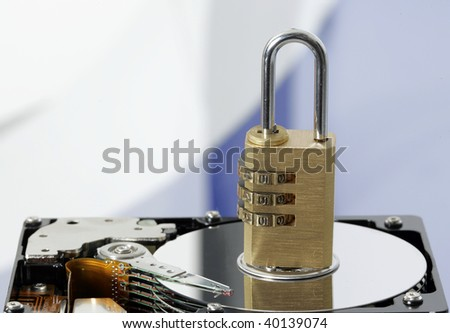 Computer hard disk with padlock - stock photo