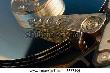 Computer hard drive without protective cover, 3 platters and 6 heads - stock photo