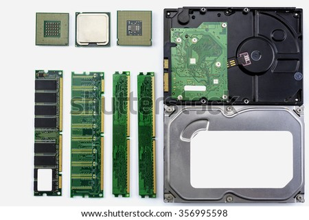 Computer hardware consists of processor, memory, hard drives, on white background./ Computer hardware - stock photo