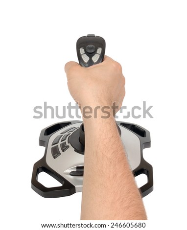 Computer joystick with hand isolated on white background - stock photo
