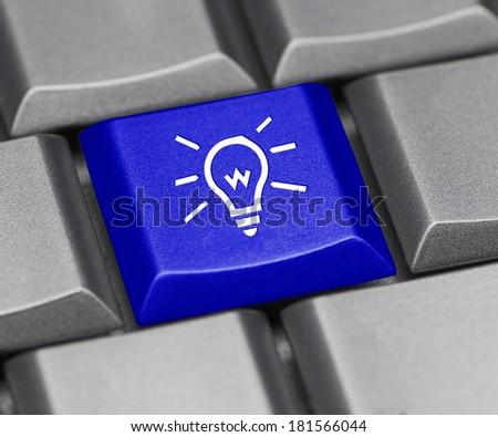 Computer key blue - light bulb - stock photo