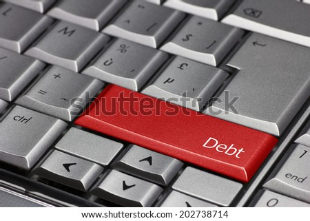 Computer key - Debt - stock photo