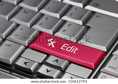 computer key - edit with hammer and chisel symbol - stock photo