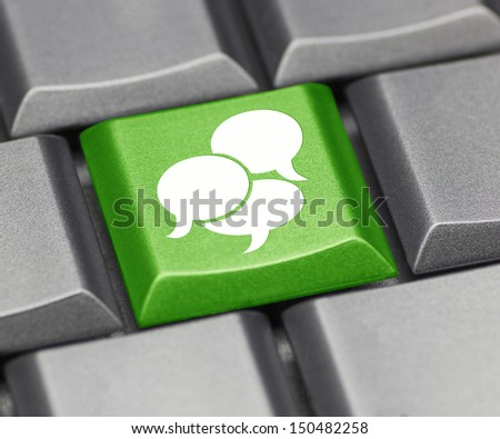 Computer key in green - text balloon suggesting social media  - stock photo