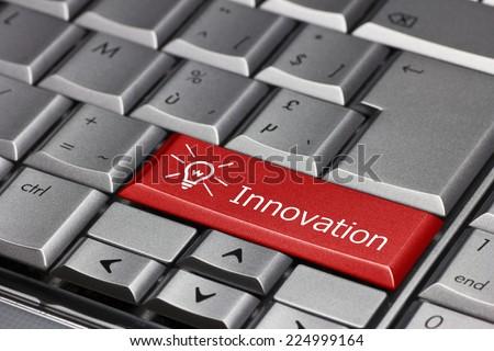 Computer key - innovation with light bulb - stock photo