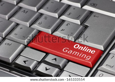 Computer key - Online Gaming - stock photo