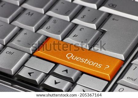 Computer key orange - Questions? - stock photo