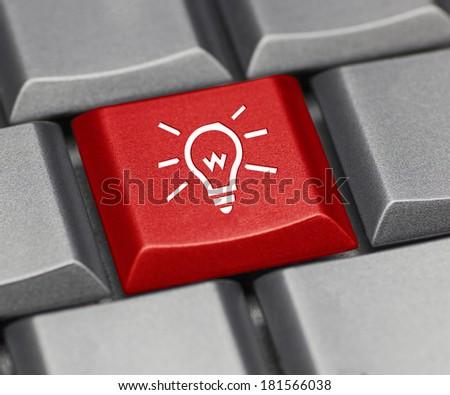 Computer key red - light bulb - stock photo