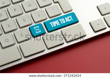 Computer key showing the word TIME TO ACT - stock photo