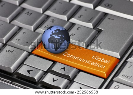Computer key with globe showing Europe and Africa - Global Communication - stock photo
