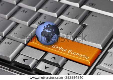 Computer key with globe showing Europe and Africa - Global Economy - stock photo