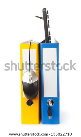 Computer keyboard and mouse in ring binder against white background - stock photo